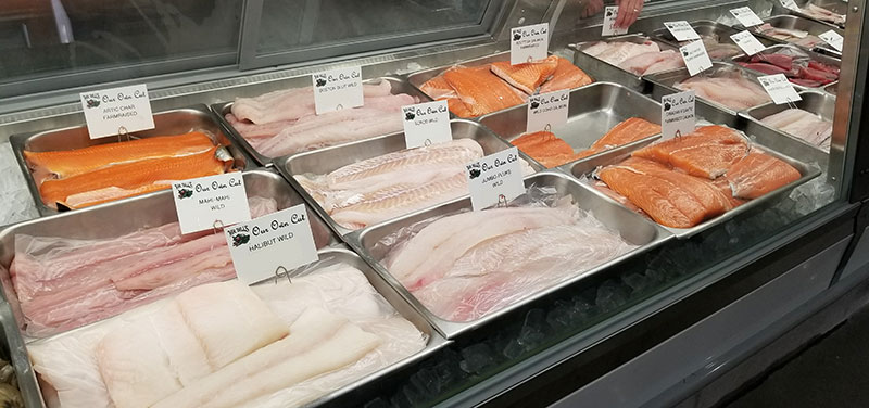 different variety of fresh fish in refrigerated case at Mr. Bill's